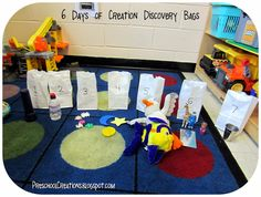 Preschool Creations: 6 DAYS OF CREATION ACTIVITIES-I love this! Either for circle time or a center. They could have fun taking the objects out of the bag as well as trying to put them back in the correct bag. It's a great review game!
