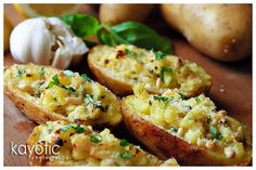Pesto Baked Potatoes - 3 potatoes (8 oz each)  1 large shallot, 2 garlic cloves, 1/2 cup cream (use low fat), 1/2 cup vegetable broth,  fresh basil, pine nuts, pepper, salt, oil