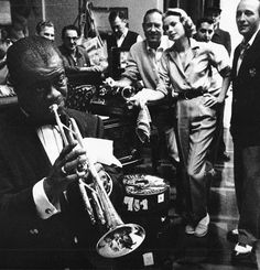 Louis Armstrong, Chuck Walters, Grace Kelly, and Bing Crosby on the set of High Society, 1956. Photographed by Bob Willoughby.