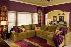 Updated traditional style living room with unusual split complimentary color scheme of eggplant, rose, and olive.