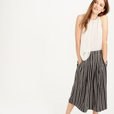 """J.Crew $110 - Pleated midi skirt in triple stripe, A paper-bag waist and engineered stripes mean this pleated A-line skirt is as flattering as it is easy. Poly. Elastic waistband. Lined. Machine wash. Sits at waist. 29"""" long. Falls below knee."""