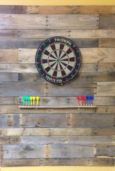Boards from 2 pallets = perfect wall for the dart board!
