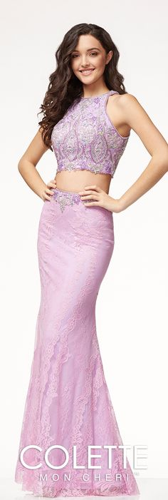 Two-piece glamorous lace prom dress with an open back, and an intricately beaded crop top with matching scalloped trim at the waist band of the skirt.