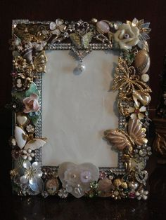 Beautiful frame made from vintage costume jewelry. by Maiden11976 #costumejewelrycrafts