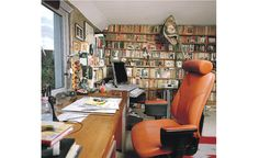 Al Alvarez' writing desk. Two surfaces, and a wall o' books in the background.