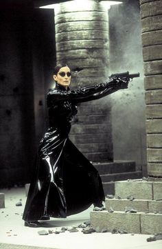 Carrie-Anne Moss: The list would be incomplete without including the Trinity of Matrix. Moss's Trinity character is Trinity is shown to be highly competent at many skills including martial arts and of course handling guns. Female Movie Characters, Movie Character Costumes, Horror Movie Costumes, Iconic Characters, Hugo Weaving, Jada Pinkett Smith, Keanu Reeves, Stanley Kubrick, The Matrix Movie