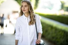 A white dress shirt is a must-have for any woman's wardrobe. See twenty fresh ways to wear a simple white button-down right now.