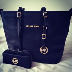#MICHAELKORS- love MK!!!!! I need to go on a shopping spree at the outlets this weekend! :) just need $39.99.