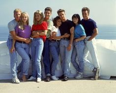 1990s  Outfit high waist jeans. plain color tee and converse.