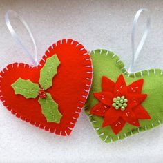A pair of beautiful hand-stitched hearts in the traditional Christmas colours of red and green.
