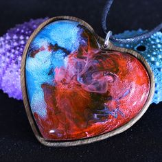 Each one of our handmade hearts represents and radiates various emotions we experience in our daily lives. So why not get one and meet the world in new colors. #woodresinnecklace #secretwood #woodheart