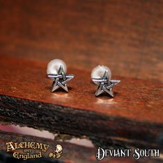 Best Seller! Alchemy Gothic E164 Pentagram Stud Earrings (pair)  A pair of tiny pewter cut-out pentagram studs, on surgical steel ear-posts.