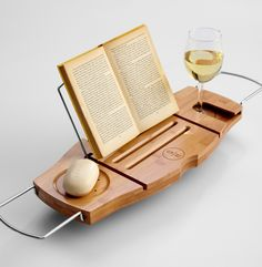 Boozy Bath Caddy: wood caddy featuring a book support and, more importantly, a holder for wine.