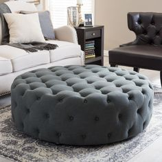 Tie your room together with the well-designed Cardiff Modern Ottoman. This large, circular footstool softens a space with its lack of angles and its versatile, neutral beige/grey linen upholstery.