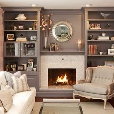 Gorgeous Moden fireplace using Cream Mother of pearl shell tile on face. Gorgeous in a grey room! https://www.subwaytileoutlet.com/products/Cream-1x1-Pearl-Shell-Tile.html#.VOpNp_nF-1U
