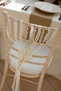 Ribbons on chair backs for wedding.