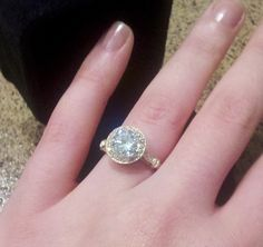 2ct. Amora Moissanite set in 14k gold antique halo setting from MoissaniteCo.com