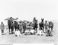 Informal group portrait of the Modelling Section with personnel and Arab servants. From left to right: Staff Sergeant K McLeod (Official Photographer), Miss Gordon (Artist from Jerusalem sent by . Staff Sergeant, Fulton, Palestine, Jerusalem, Egypt, War, Horses, Indian, Group