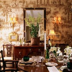Toile in the dining room...via Andrea and My French Home.  Such a cozy and elegant dining room.