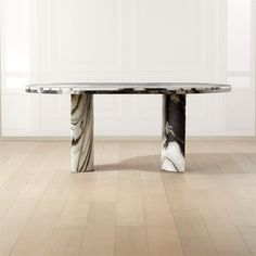Graphic black and white spider marble with subtle green undertones defines this oval statement dining table by Brett Beldock. Half-cylinder legs are hand-chiseled on the outside for a raw finish that makes them look found. Legs may continue to chip over time, only adding to the beauty and uniqueness of the table. Honed marble tops the piece.