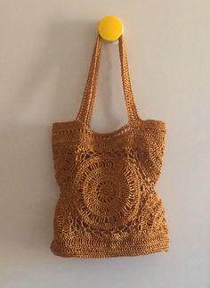 Golden raffia circles bag.