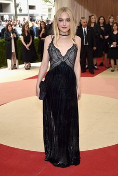 Met Gala 2016: Dakota Fanning Wearing Nina Ricci gown, heels, and clutch.