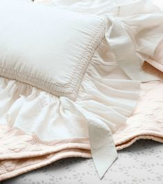 feminine ruffles in soft colors for a sweetly sophisticated feel.