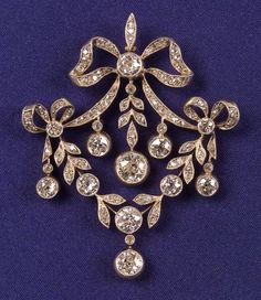 Edwardian Diamond Pendant, designed as ribbon and swag motifs bezel and bead-set with old European, old mine and old single-cut diamonds, approx. total wt. 5.15 cts., millegrain accents, platinum-topped 14kt gold mount, suspended from a delicate platinum trace link chain, lg. 15 in., fitted English jeweler's box