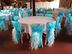 Turquoise Organza Hoods with Pale Ivory Ruffles. Set-up by Chair Covers for Celebrations.