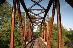 Abandoned 1932 railroad truss bridge over Big Sand Creek in Carroll  County, Mississippi.  The bridge is a Warren through truss bridge