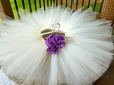 Ivory tutu with plum flower by LittleMissLovelyGal on Etsy, $30.00