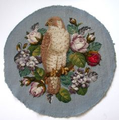 It is worked in raised wool plush work or turkey work with needlepoint tapestry and beadwork. A superb and rare round Antique Victorian picture or panel. It features a bird, which is either a Falcon or a Hawk. Victorian Pictures, Wool Yarn, Needlepoint, Lamb, Needlework, Decorative Plates, Textiles, Tapestry, Birds