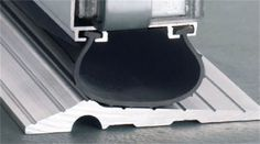 Stop Draft Seals and Bottom Retainers : Threshold for garage doors, keeps water from seeping in. $4.99 per foot