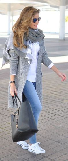 Shop this look on Lookastic: https://lookastic.com/women/looks/coat-dress-shirt-skinny-jeans/13619 — Navy Sunglasses — Grey Plaid Scarf — White Dress Shirt — Grey Coat — Black Leather Watch — Blue Skinny Jeans — Black Leather Tote Bag — White Low Top Sneakers