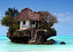 Restaurant on a cliff on the east coast of Zanzibar. Depending on tide you can reach it by foot or by boat.