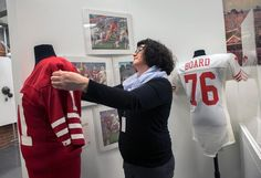 NUMU History curator displaying Forty Niner jersey | The Road to Super Bowl XIX