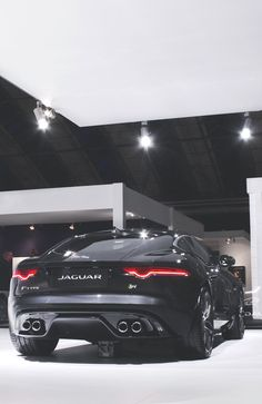 Jaguar F-type in black. Ooh it's a mean looking car!