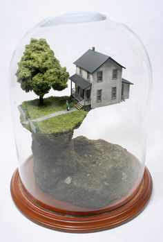 New York based artist Thomas Doyle creates miniature worlds in bell jars. Doyle's work often deals with the interplay of domestic life and destruction, love and anguish, memory and chaos, frozen in fragile instants and evoking feelings of omnipotence in the viewer, as if he's recalling an event of the not so distant past.