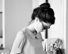 blouse, bun, glasses