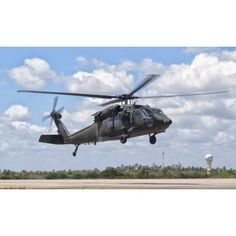 A Brazilian Air Force UH-60L Black Hawk at Natal Air Force Base Brazil Canvas Art - Giovanni CollaStocktrek Images (37 x 22)