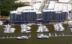 Beautifully decorated 1 Bedroom Wharf unit with spacious interior, built in bunks, sleeper sofa, high end kitchen and large private balcony. Enjoy views of the Wharf Marina, watch the boats on the ICW and take advantage of the incredible Oasis pool and water park for your family and your guests exclusively. The Wharf offers some of the best eateries, shopping and entertainment on the island, movie theater, special events and more just out your front door. Unit has been a solid rental…