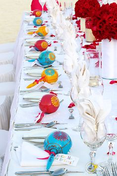 Our reception table: white with splashes of vibrant color. Custom maracas I designed which were inspired by Mexican Christmas ornaments I brought home from my first trip to Mexico & implemented exquisitely by Mishka Designs team! I LOVEd how they turned out!!!