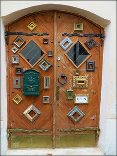 Doors of Old Town store in Vilnius, Lithuania. Do picture frames count as vision lite kits? Not sure, but this seemed the best board for this pair of doors.