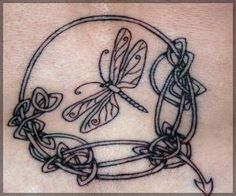 knot work dragonfly tattoo