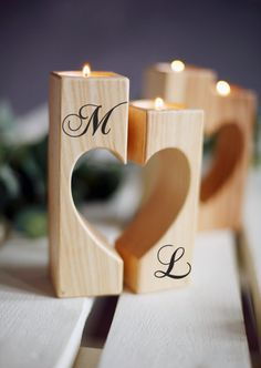 Personalized wedding candle holders. These are wonderful to have as a centerpiece for gift, a wedding or for home decor. This rustic heart shaped candle holder made : Size 5.51 x 4 inch (14 x 10cm) Please, keep in mind common fire safety regulations when using this candle holder. Do not leave lit candles unattended. Candles used in these candle holders must be contained in a plastic or metal casing. *The holders may vary from the set in the picture since many different species of wood a...