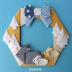 """「こまごま市」展示作品より。冬のリースです^ ^各折り紙作品の折り方はプロフィールにリンクがあるYouTube""""のkamikey origami """"チャンネルでご覧ください   Hexagonal wreath Rabbit  Fir tree  Bow designed by me Tutorial on YouTube"""" kamikey origami"""" #折り紙#origami #ハンドメイド#kamikey"""