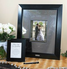 alternative guest book- have guests sign a picture frame & put your wedding photo in it later for the house