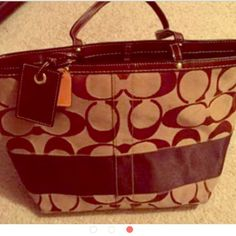 Coach signature stripe tote bag Great condition, looks brand new. This tote bag has a brown stripe and can be reversible. Small spot that can barely be seen (pictured). Other than that it's a perfect bag. Coach Bags Totes