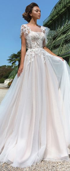 Graceful Tulle Jewel Neckline A-line Wedding Dress With Lace Appliques & Beadings