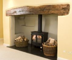 Image result for woodburner in stone inglenook style fireplace
